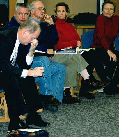 Region 12 Superintendent of Schools Dr. Richard Carmelich, front left, reflects the challenge faced by steering committee at a Shepaug Valley elementary school hearing on Jan. 25, 2006 Photo: Norm Cummings, Norm Cummings/Spectrum / The News-Times