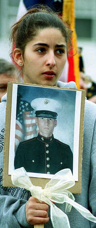 SPECTRUM/Jennifer Oliveira of New Milford attends a March 29, 2003 rally on the Village Green to support U.S. troops, proudly clutching a photograph of her brother, Matt Oliveira, Photo: Deborah Rose, Deborah Rose/Spectrum / The News-Times
