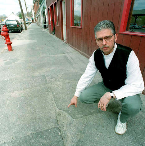 Joe Pesente, a co-owner of the former Youngs Hotel building, fought a long and ultimately successful fight to have Railroad Street sidewalks be refurbished. April 13, 1999.  Spectrum file photo Photo: Contributed Photo