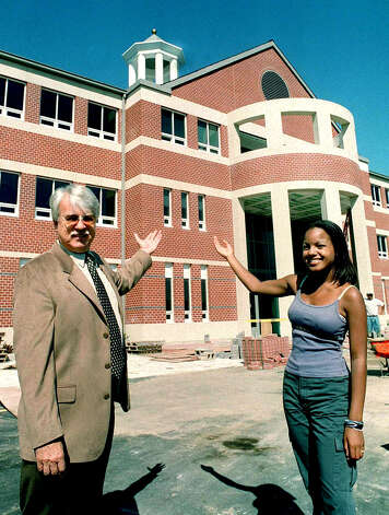 Principal Donald Fiftal and Student Council president Erica Harris offer a welcome to the new New Milford High School along Route 7 South in late summer of 2000 Photo: Norm Cummings
