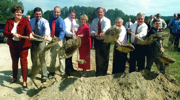 Combining their talents during the groundbreaking for the Route 7 project in New Milford are, from left to right, state legislators Mary Ann Carson, Andrew Roraback, Clark Chapin and David Scribner, Lt. Gov. Jodi Rell, Gov. John Rowland, state legislator Louis DeLuca, a state DOT reppresenatative and Mayor Bob Gambino. Photo: Norm Cummings