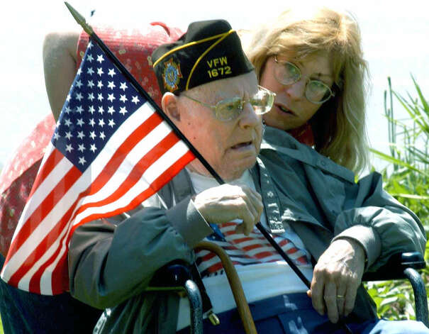 Peter Henderson Sr., 89, a World War II veteran, bonds with his daughter during New Milford's Memorial Day ceremony on May 30, 2005 Photo: Norm Cummings, Norm Cummings/Spectrum / The News-Times