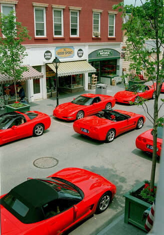 "Shiny, red Corvettes line Bank Street in New Milford during the filming of the Adam Sandler movie,  ""Mr. Deeds."" Photo: Deborah Rose, Deborah Rose/Spectrum / The News-Times"