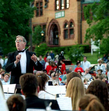 Longtime director Al Bayers conducts the New Milford High School band on the Village Green during a concert to promote the 100th anniversary of New Milford Public Library on June 6, 1998.  Spectrum file photo Photo: Contributed Photo
