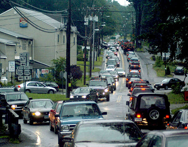 Rush-hour and New Milford Village Fair Days traffic mix at about 5 p.m. to create near gridlock at the intersection of Bridge and East streets with Route 67, shortly after a thunderstorm-induced early closing of the fair on July 28, 2006 Photo: Norm Cummings