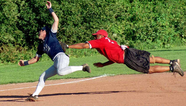 Acrobatic Savings Bank third baseman Rob Brown tags out B & B Mason runner John Bernardi near third base as New Miford Parks &b Recreation men's and women's slowpitch softball nears its annual late-summer climax. Photo: Norm Cummings
