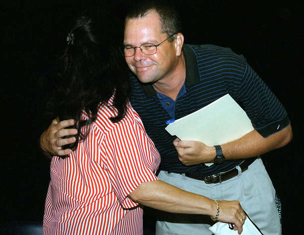 Bill Knipple, the 2002 New Milford teacher of the year, shares a hug with Sarah Noble teacher Claudia Banks on Aug. 28, 2002  Spectrum/After Cathy Setterlin of New Milford gets assistance with a spinning demonstration from Isabella Gimenez, Ms. Setterlin ties a woven bracelet onto the seven-year-old's wrist at Sunny Valley Preserve's Open Farm Day held Sept. 17, 2011 in New Milford. Photo: Deborah Rose