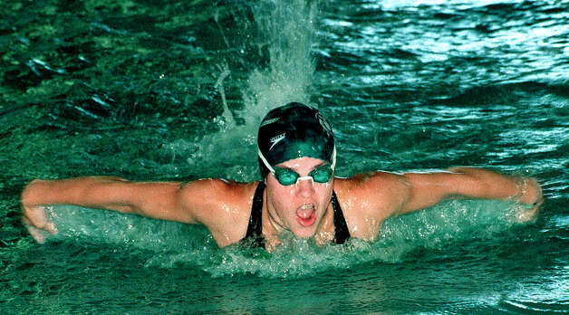 Emily Ferrier churns out her butterfly race at the Canterbury School pool for the New Milford High School girls' team. Photo: Norm Cummings, Norm Cummings/Spectrum / The News-Times