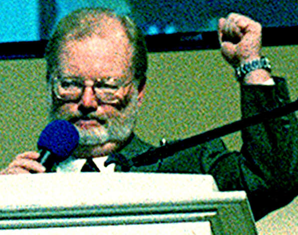 "Building Committee chairman Bob McCarthy offers an emphatic ""We did it!"" during the New Milford High School dedication ceremony in 2000 Photo: Norm Cummings"