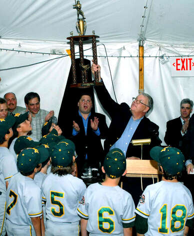 John Kaiser of MVP-SOS holds aloft the trophy won this summer by New Milford Youth Baseball/Softball's Express 9-year-old baseball team during its run to state and New England championships, during the Sept. 8, 2007 MVP-SOS benefit dinner at the Arion Singing Society.  Courtesy of Nicole Pliego Photo: Contributed Photo