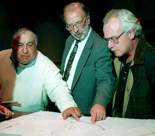 Developer Tom Pilla, left, Adam Halasi-Kun, center, chairman of the New Milford Conservation Commission and president of the Weatinoge Land Trust, and Conservation Commission member Michael-John Cavallaro of New MIlford look in October 1998 at a site plan for proposed changes to the Still Meadow property prior to a town meeting about the site off Route 7.. Fifteen years later, the future of the property is still to be determined. Photo: Norm Cummings