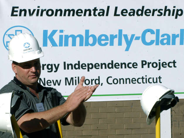 Chuck Smith, the manager for the 2007 energy independence project at Kimberly-Clark in New Milford, applauds everyone's efforts during a groundbreaking ceremony. Photo: Norm Cummings
