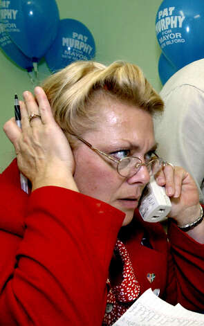 Pat Murphy strains to hear voting results over the phone as they come in from various New Milford polling districts in November 2003, the first of her five successful mayoral runs... and counting. Photo: Carol Kaliff