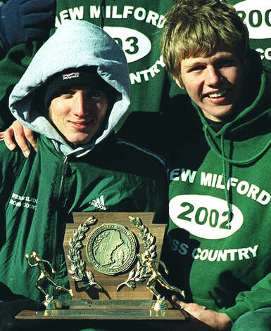 Ben Danton, left, and Reid McEwen key New Milford High School boys' cross country's run to the first of two straight New England championships on Nov. 8, 2003 at Derryfield Park in New Hampshire.  Courtesy of Sue Fisher Photo: Contributed Photo, Courtesy Of Sue Fisher / The News-Times Contributed