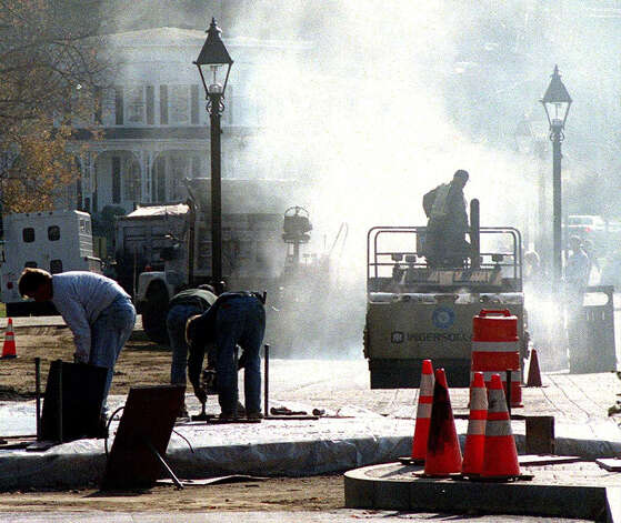 Steam rises from the paving of the west side of Main Street in New Milford during the town's downtown major renovation project. Photo: Norm Cummings/Spectrum