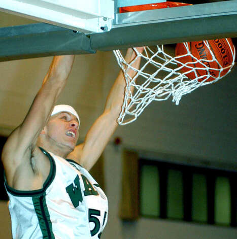 The Green Wave's electrifying Todd Ward is shown dunking the ball for New Milford High School boys' basketball vs. East Granby on Dec. 27, 2004 during the Tipoff Classic at Western Connecticut State University in Danbury. Photo: Norm Cummings, Norm Cummings/Spectrum / The News-Times