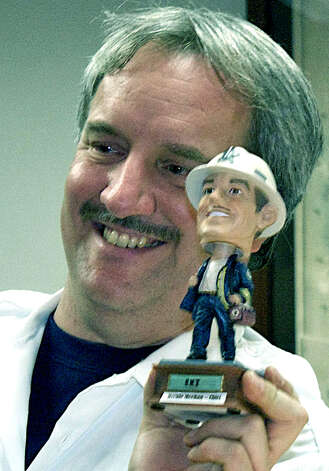 Bernie Meehan, quintessential smalltown volunteer and the chief of the Roxbury Ambulance Association, proudly shows off a bobblehead doll he received Jan. 6, 2009 during the annual dinner at town hall in Roxbury. Photo: Trish Haldin