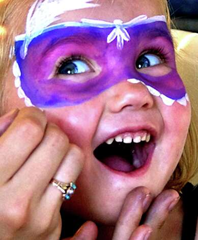 Hannah Patrick, 3, of New Milford clearly enjoys the experience as she has her face painted by Katie Linke from the Village Center for the Arts during the Greater New Mford Chamber of Commerce's 2010 Village Fair Days. Photo: Trish Haldin