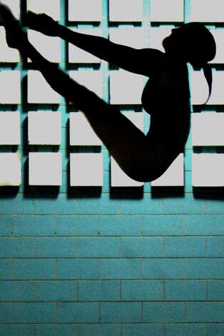 This exquisite 2007 image of Spartan diver Courtney Weaving reflects the stirring dominance by the Shepaug Valley High School swimn team over its Berkshire League rivals for many years. Photo: Norm Cummings