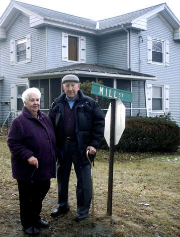 Betty Waldron and Gordon Waldron stand in front of their former home, 48 Grove Street, at the intersection with Mill Street in New Milford, during the early stages of the Grove Street/Route 67 realignment project, Feb. 2, 2008 Photo: Norm Cummings