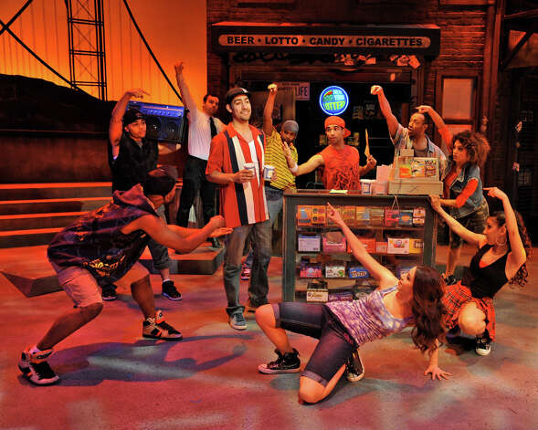 "Perry Young as Usnavi (center) and the dance ensemble perform in a scene from ""In the Heights,"" at Westchester Broadway Theater in Elmsford, N.Y. Photo: Contributed Photo"