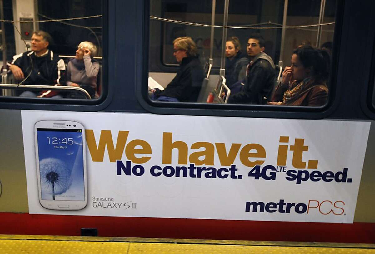 In this file photo, passengers depart on an outbound Muni Metro train at the Montgomery station in San Francisco.