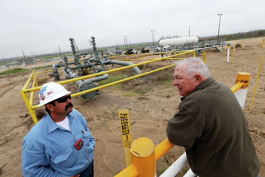 Paul Bordovsky, 90, right, talks with Lupe Gutierrez, of Conoco, at his ranch a few miles east of Karnes City, Thursday, Feb. 7, 2013. The retired pharmacist and his wife, Emily, bought the 640 acres ranch in 1970 and sometime in 2009, Conoco-Phillips staked out a well on his ranch. Conoco-Phillips took more that a year to drilled and frack the first deep horizontal well in Karnes County. For the month of November 2012, the county ranked first for oil production in Texas with 3 million barrels. Bordovsky sold part of his ranch to Conoco-Philips and Koch Industries that now serves as pipeline transfer stations. Photo: Jerry Lara, San Antonio Express-News / ©2013 San Antonio Express-News