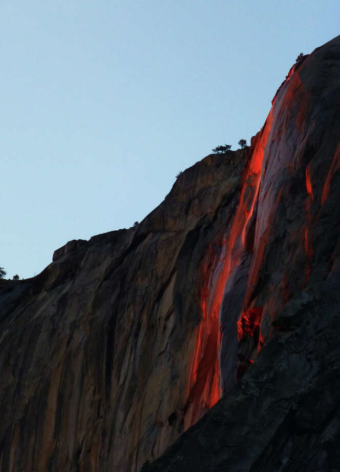 Conditions synchronized at dusk Saturday to turn Horsetail Fall in Yosemite Valley into a firefall. This image is untouched, non Photoshopped or enhanced in any way.