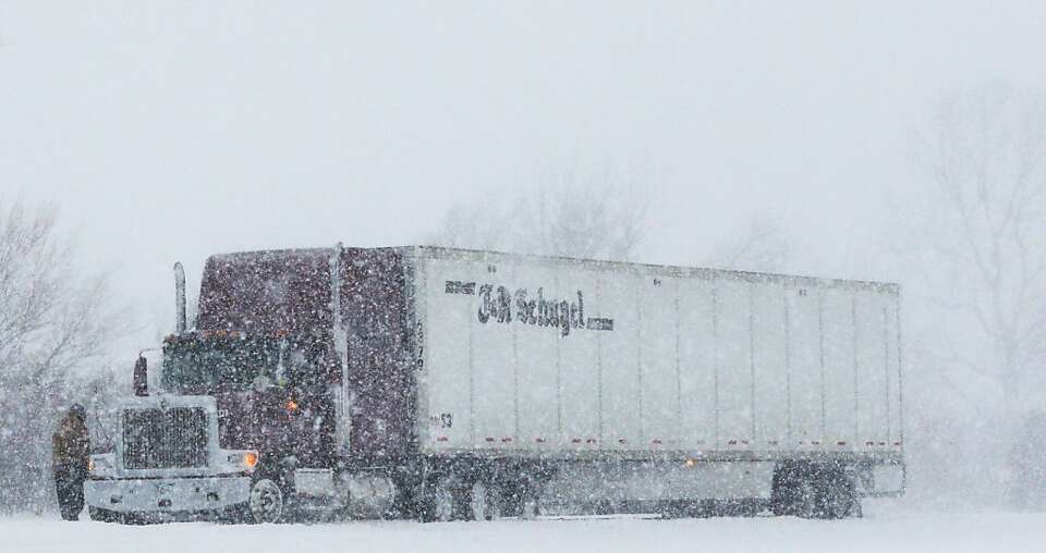 A trucker stops in almost whiteout conditions along K-10 highway near Eudora, Kan., Thursday, Feb. 2