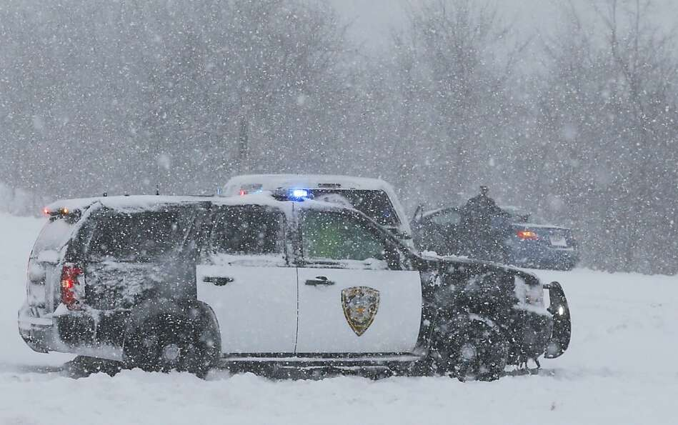 A Lenexa Police vehicle stops to aid motorists stuck on a ramp to I-35 in Lenexa, Kan., Thursday, Fe