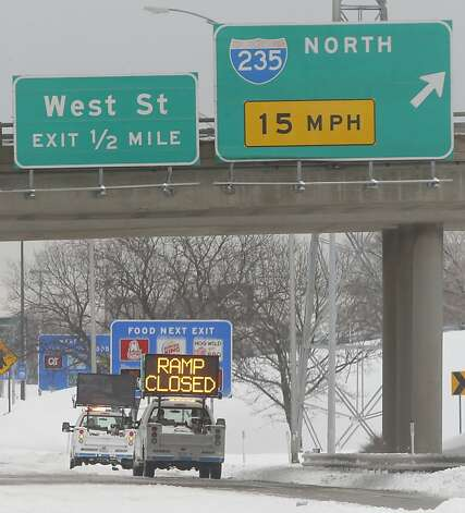 The exit ramp from east bound Kellogg to I-235 northbound is closed Thursday, Feb. 21, 2013 after a tractor trailer got stuck on the ramp. Numerous cars and trucks were stuck or off the road as nearly a foot of snow fell across the area. Kansas was the epicenter of the winter storm, with parts of Wichita buried under 13 inches of still-falling snow, but winter storm warnings stretched eastern Colorado through Illinois. (AP Photo/The Wichita Eagle, Bo Rader) Photo: Bo Rader, Associated Press
