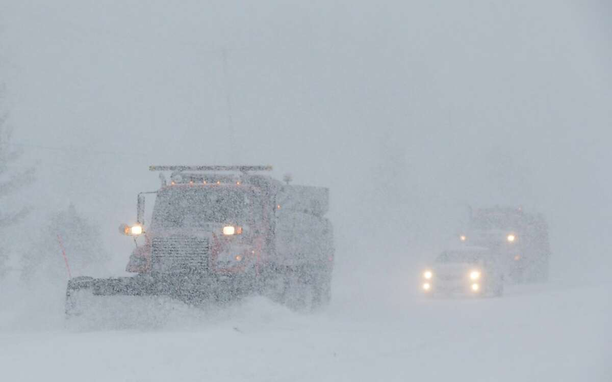 Kansas state average: 72 mph. File photo of a plow trying to clear Shawnee Mission Parkway in the Kansas City suburb of Shawnee Mission, Kansas, Thursday, Feb. 21, 2013.