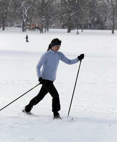 Porter McKinnon cross country skis in Washington Park in Denver on Thursday, Feb. 21, 2013. A fast moving winter storm passed through Colorado Wednesday night and Thursday morning dropping as much as a foot of snow in areas of the state. (AP Photo/Ed Andrieski) Photo: Ed Andrieski, Associated Press