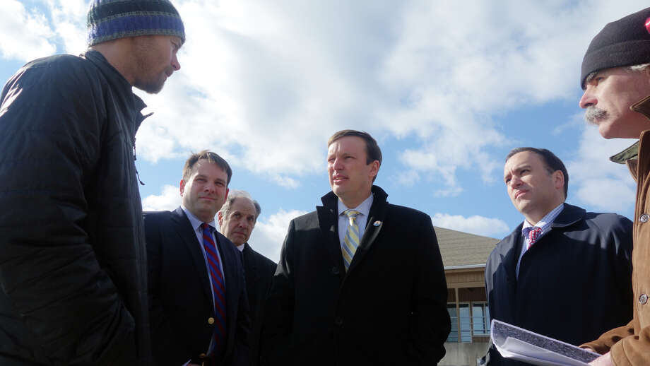 Senator Chris Murphy, center, stops along the Mianus River to speak with, from left, oyster farmer Jadar Nygaard, Selectman Drew Marzullo, Chairman of the Selectman's Harbor Management Advisory Board Gary Silberberg, First Selectman Peter Tesei and Harbormaster Ian Macmillan as Murphy visits Greenwich to discuss federal block grants and other funding Feb. 20, 2013. Photo: Keelin Daly / Keelin Daly