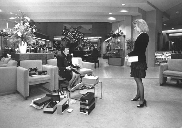 Mimi Moore, right,  gives a customer individual attention in the shoe department at the Saks Fifth Avenue store in the Stamford Town Center mall in 1987. Photo: File Photo / Stamford Advocate File Photo