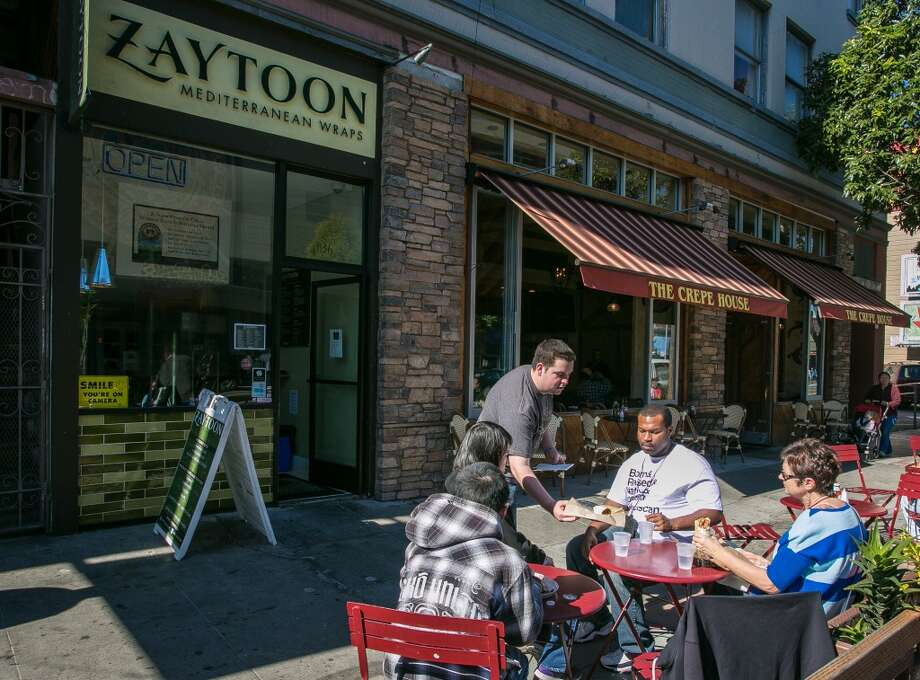 People enjoy lunch at Zaytoon.