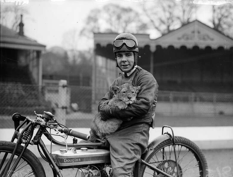 Motorcyclist Triss Sharp and his pet lion cub mascot at Crystal Palace in London, 1930.