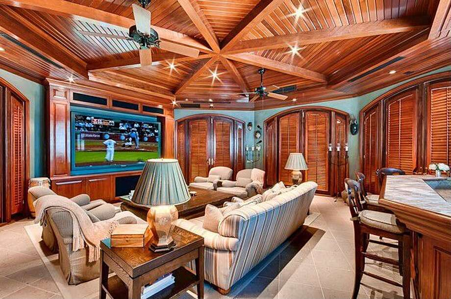 Great theater for watching basketball games. All photos via Zillow/Esslinger-Wooten-Maxwell Inc.