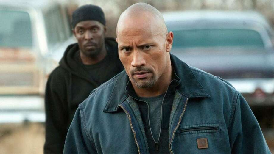 "Dwayne Johnson plays the father of a man wrongfully arrested for dealing drugs in ""Snitch."" Photo: Summit Entertainment"