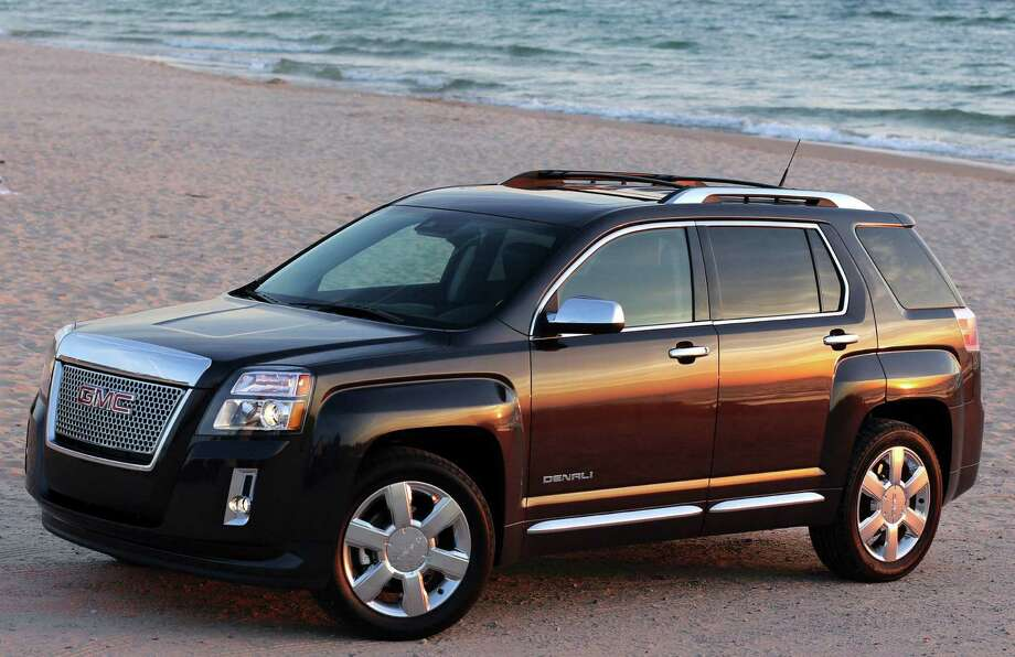 For 2013, GMC adds the upscale Denali trim level to the Terrain, its five-passenger midsize crossover. The Denali features the signature chrome grille, and advanced camera-based safety features offered as options on the other Terrain models. Photo: General Motors Co.