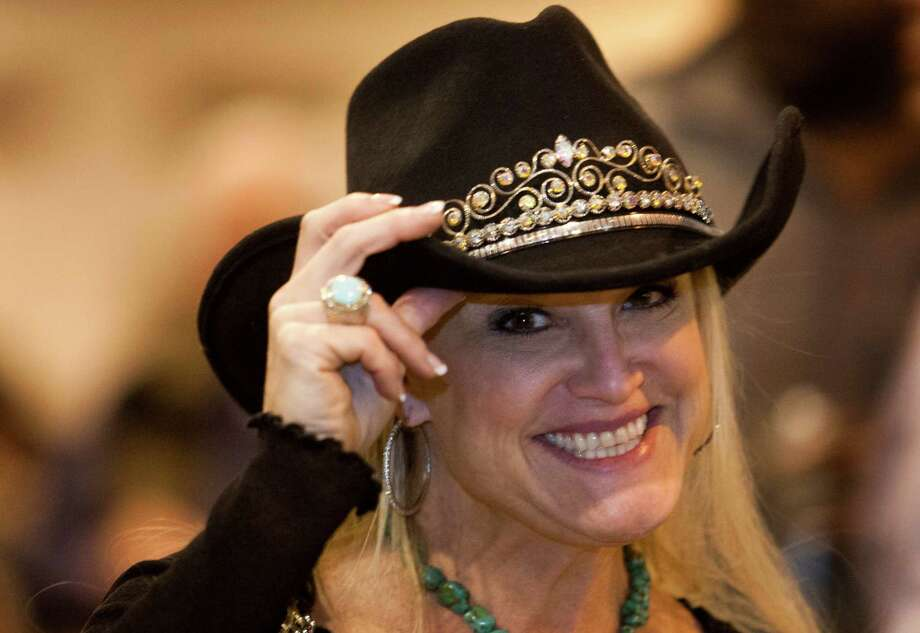 Londie Lane shows off her cowboy hat during Rodeo Uncorked.Joy Sewing has more on all the hot rodeo style. Photo: J. Patric Schneider, Freelance / © 2013 Houston Chronicle