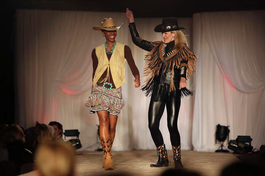 Models hit the runway with fashions from Julian Gold during the Cowgirls Live Forever Fashion Show a