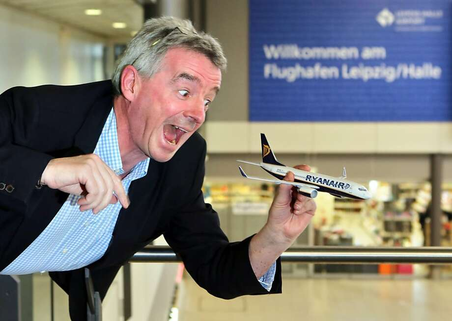 "Zoooooom! Wheee! Ryanair CEO Michael O'Leary, who never really outgrew playing with model airplanes, ""flies"" his airliner inside the Leipzig/Halle airport in Schkeuditz, Germany. Ryanair intends to increase the company's stake in the eastern German airport. Photo: Jan Woitas, AFP/Getty Images"