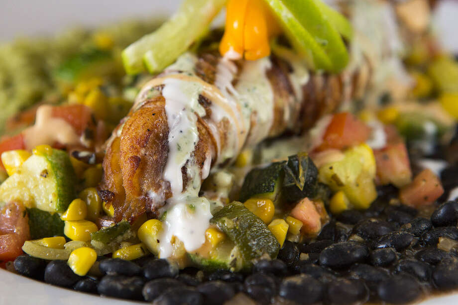 Potato-crusted red snapper is a standout dish at Firebird Mexican Grill. It's served with a mixture of calabacita with corn and black beans and poblano rice. Photo: Photos By Michael Miller / For The Express-News
