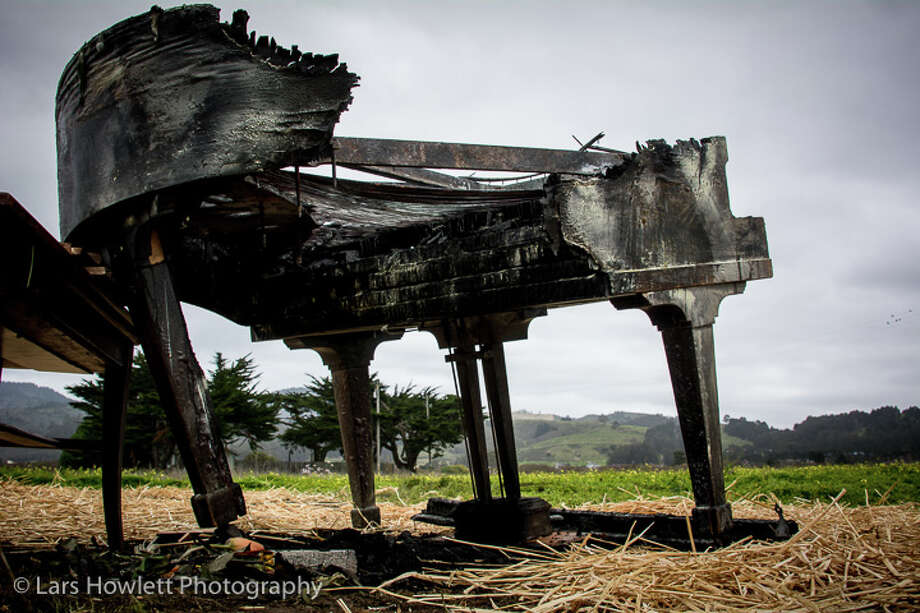 The piano's ashes still held together in daylight the morning after the cremation.