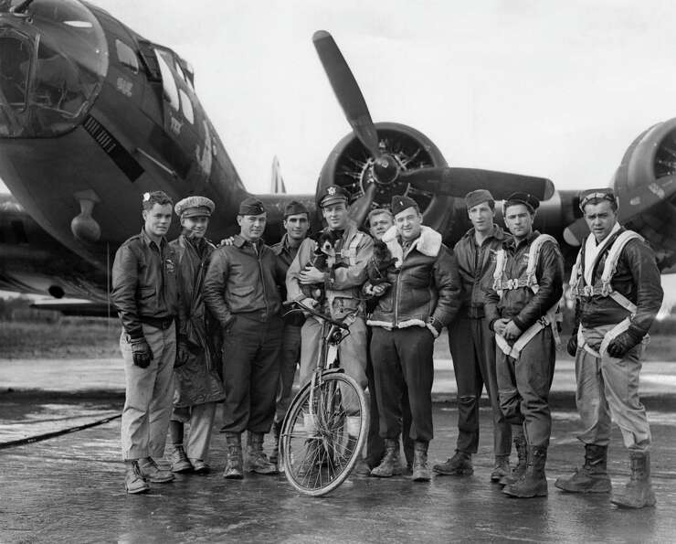 American pilot Robert W Biesecker and his crew standing by their B-17 Flying Fortress bomber 'Honey
