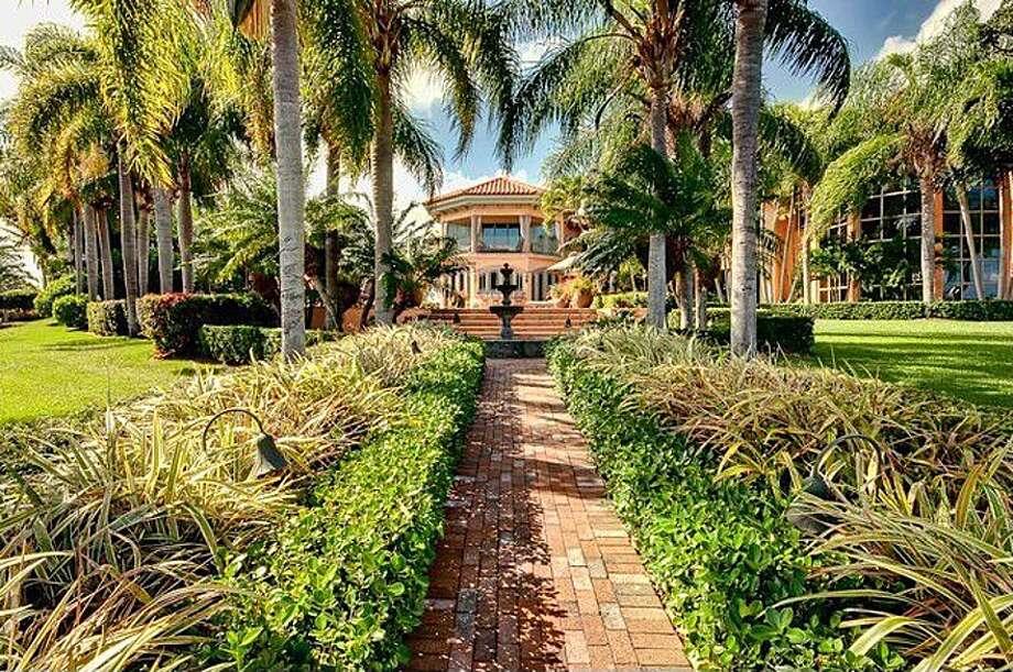 Walking toward doomed mansion. All photos via Zillow/Esslinger-Wooten-Maxwell Inc.