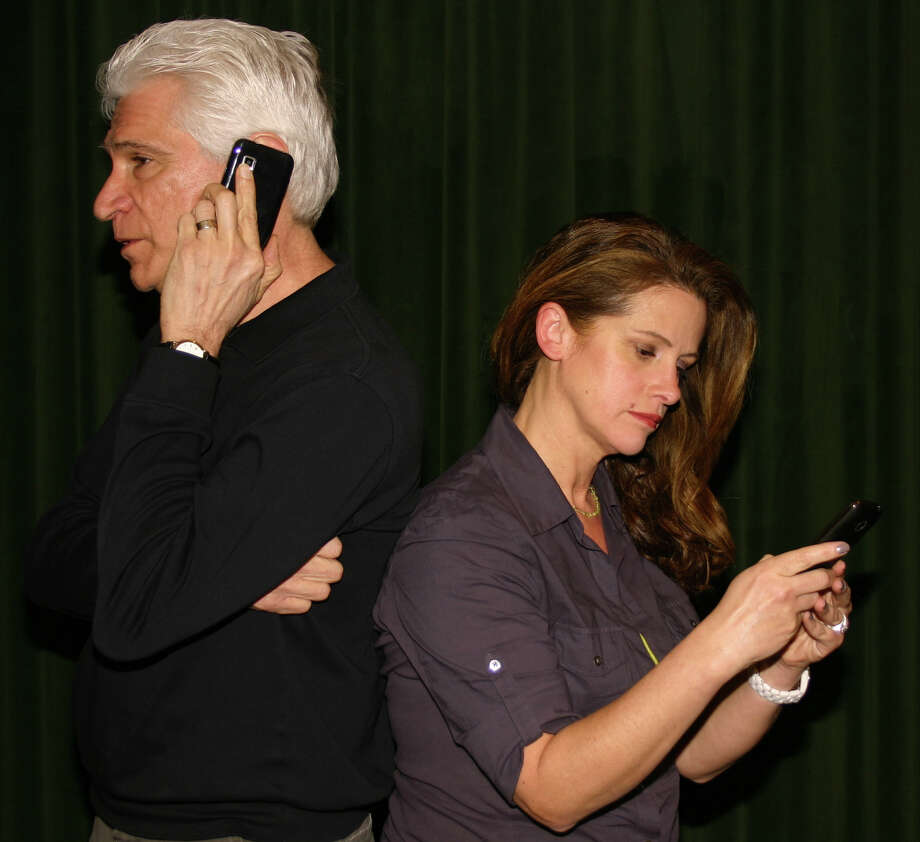 "Pat Leo and Lillian Garcia wrestle with the behavioral problems of their child in ""Distracted,"" the 2009 play by Lisa Loomer that is receiving its state premiere at the Square One Theatre in Stratford March 1 to 16. Photo: Contributed Photo"