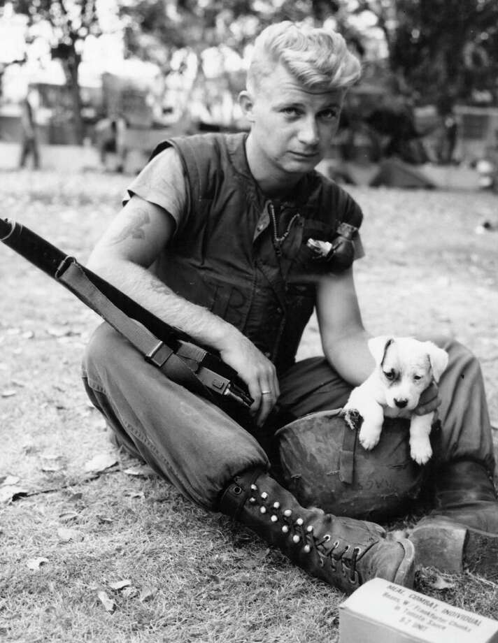 Marine Corporal J. Laursen of San Jose, California is taking time out from patrol duty in Santo Domingo, the focal point of the rebellion in the Dominican Republic, 1965. Photo: Hulton Archive, Getty Images / Hulton Archive