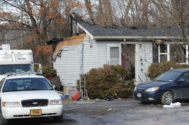 Scene of fatal fire at 170 Glenmont Road on Thursday Feb. 21, 2013 in Glenmont, N.Y. .(Michael P. Farrell/Times Union) Photo: Michael P. Farrell
